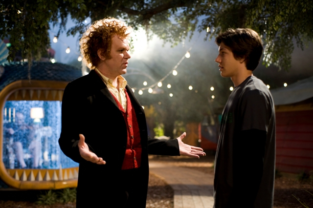 (L to R) Crepsley (JOHN C. REILLY) makes a curious proposal to Darren (CHRIS MASSOGLIA) in ?Cirque Du Freak: The Vampire?s Assistant?.  In the fantasy-adventure, one teen will vanish from the safety of a boring existence and fulfill his destiny in a place drawn from nightmares.