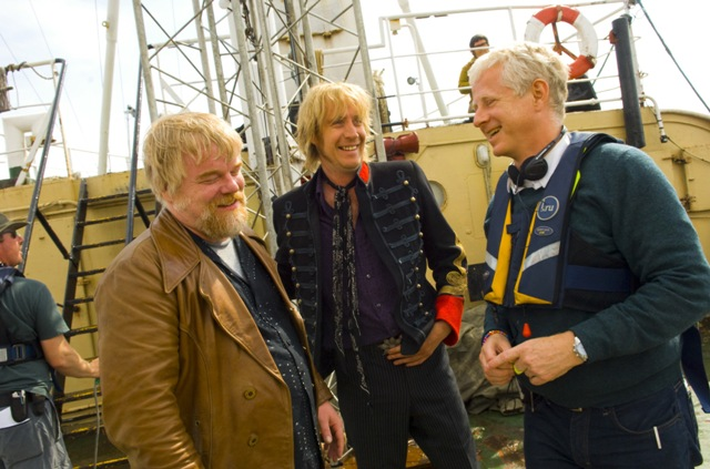 Philip Seymour Hoffman and Rhys Ifans share a moment with director Richard Curtis on the set of the new comedy Pirate Radio.Ê Photo Credit: Alex Bailey
