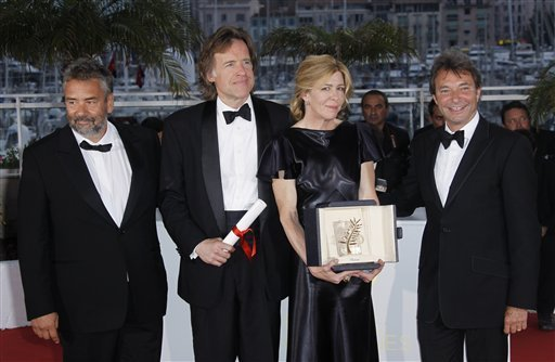 Producers Luc Besson, Bill Pohlad, Dede Gardner and an unidentified guest pose with the Palme d'Or for director Terrence Malick's The Tree of Life.