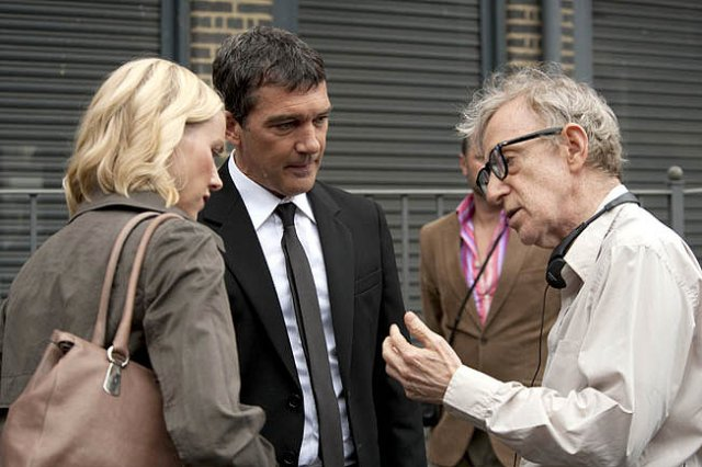 Naomi Watts and Antonio Banderas are directed by Woody Allen on the set of You Will Meet a Tall Dark Stranger.