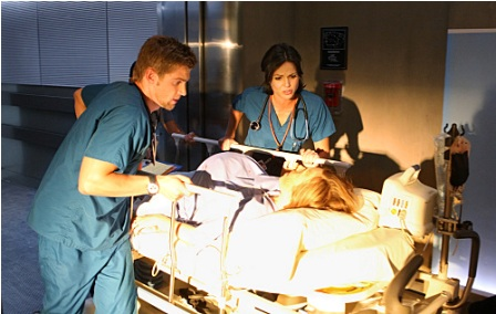 Dr. C (Mike Vogel) and Dr. Zambrano (Lana Parrilla, right) treat a trauma patient on