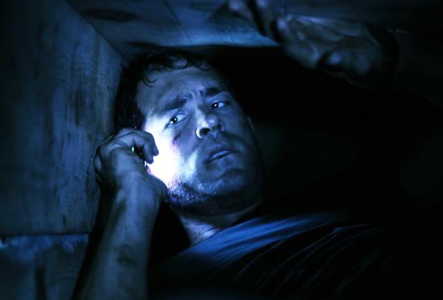 Down in the Depths: Ryan Reynolds as Paul Conroy in 'Buried'