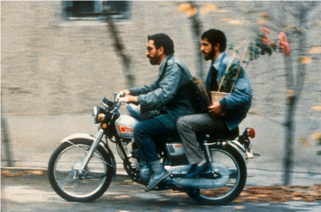 Iranian filmmaker Mohsen Makhmalbaf gives a ride to the man who impersonated him, Hossein Sabzian, in Abbas Kiarostami's 1990 masterpiece Close-Up.