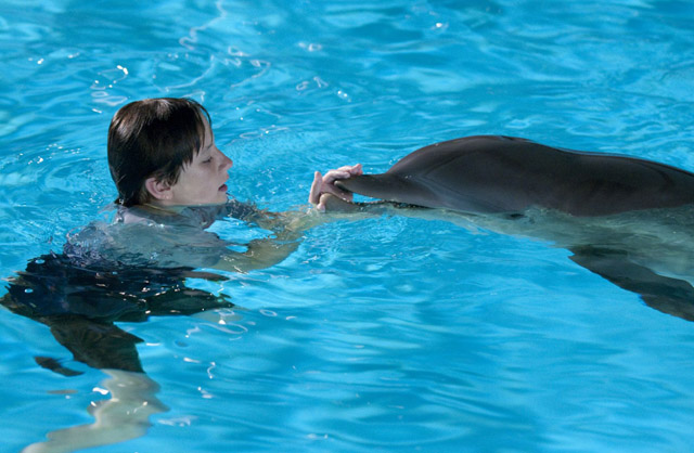 Boy and His Dolphin: Nathan Gamble as Sawyer with Winter in 'Dolphin Tale'