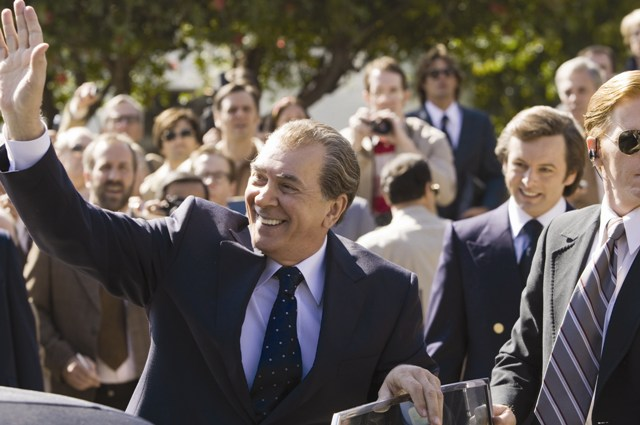Richard Nixon (Frank Langella) greets an audience while David Frost (Michael Sheen) looks on.