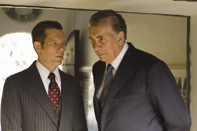 Colonel Jack Brennan (Kevin Bacon) counsels Richard Nixon (Frank Langella) in