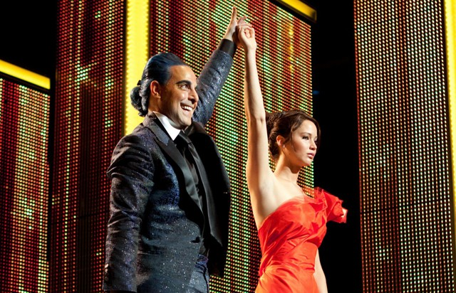 Glitz: Stanley Tucci (Caesar) and Jennifer Lawrence (Katniss) in 'The Hunger Games'
