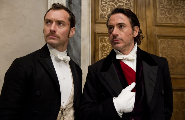 Game is Afoot: Jude Law as Dr. Watson and Robert Downey Jr. as the Title Detective in 'Sherlock Holmes: Game of Shadows'