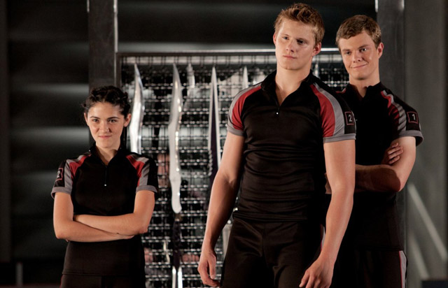 Isabelle Fuhrman (Clove) with Career Tributes Alexander Ludwig (Cato) and Jack Quaid (Marvel) in 'The Hunger Games'