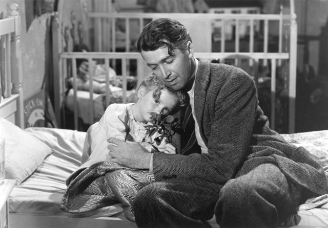 Karolyn Grimes and James Stewart mend petals and hearts in Frank Capra's It's a Wonderful Life.