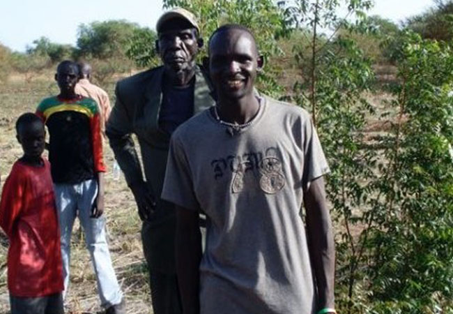 Get Back: Kuek Aleu Garang with His Father at the Site in Wernyol, Sudan Where He was Born in '22 Years From Home'