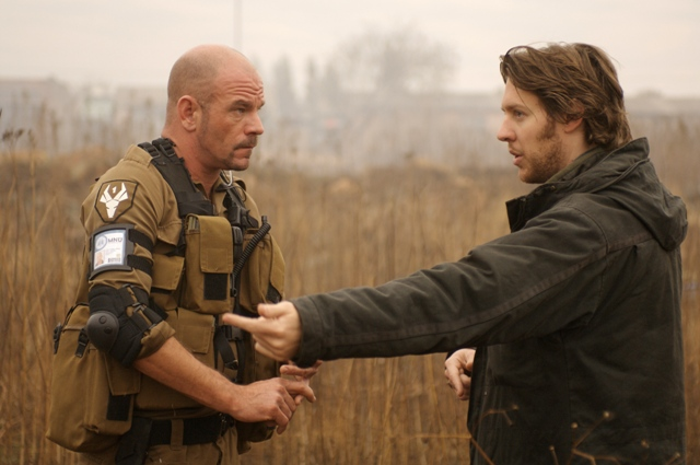 David James (left) and Director Neill Blomkamp on the set of TriStar Pictures' sci-fi thriller DISTRICT 9.