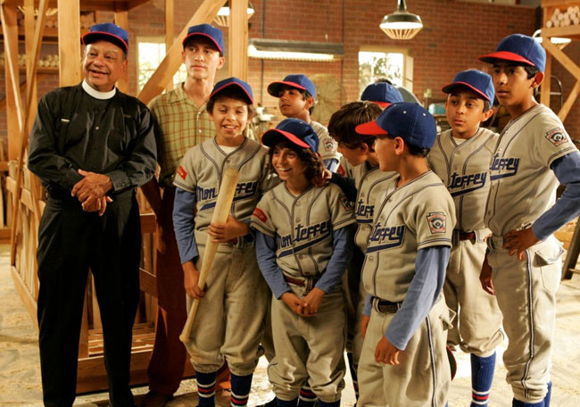 Cheech Marin (left) as Padre Estaban and Clifton Collins Jr. (next to Marin) as Coach Cesar with the Little Leaguers of 'The Perfect Game'