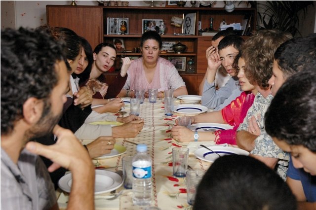 Bouraouïa Marzouk (center) plays the matriarch of a sprawling French Arab family in Abdellatif Kechiche's The Secret of the Grain.