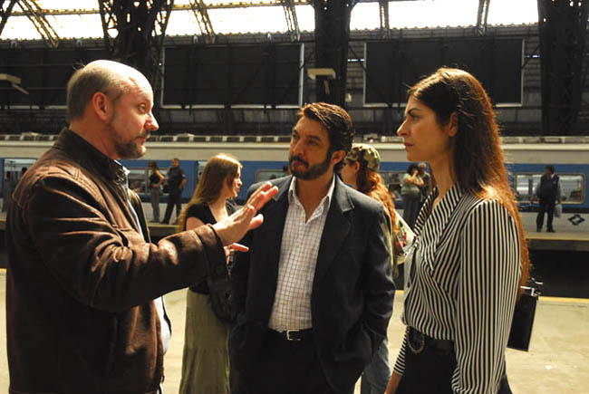 "On Set: Director Juan José Campenella Sets Up a Shot with Ricardo Darín and Soledad Villamil in ""The Secret in Their Eyes'"