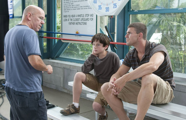 Charles Martin Smith (left) directs Nathan Gamble and Austin Stowell in 'A Dolphin Tale'