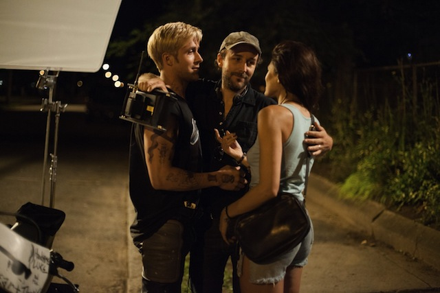 Ryan Gosling, director Derek Cianfrance and Eva Mendes embrace on the set of The Place Beyond the Pines, a Focus Features release.