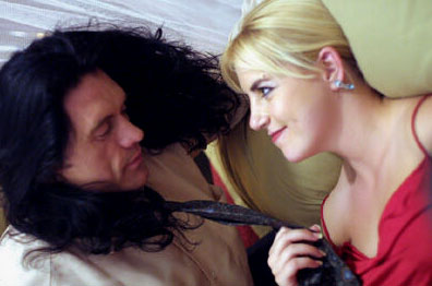 Tommy Wiseau and Juliette Danielle star in The Room.