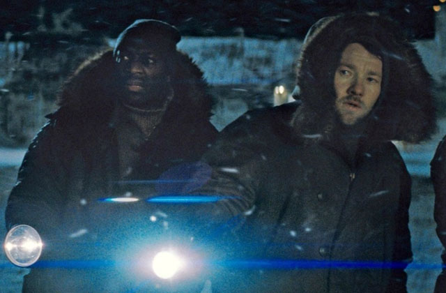 Adewale Akinnuoye-Agbaje as Derek and Joel Edgarton as Sam in 'The Thing'