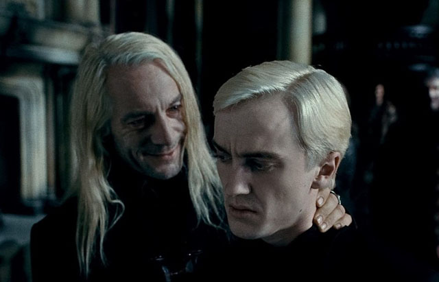 Jason Isaacs as Lucius Malfoy and Tom Felton as Draco in 'Harry Potter and the Deathly Hallows: Part 1'
