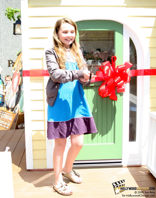 Abigail Breslin cuts the ribbon on June 17, 2008 at the Chicago opening of Kit's Home on Abbott Place by American Girl for the film Kit Kittredge: An American Girl