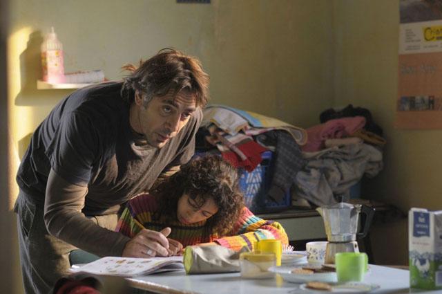 Everyday People: Javier Bardem as Uxbal and Hanaa Bouchaib as Daughter Ana in 'Biutiful'