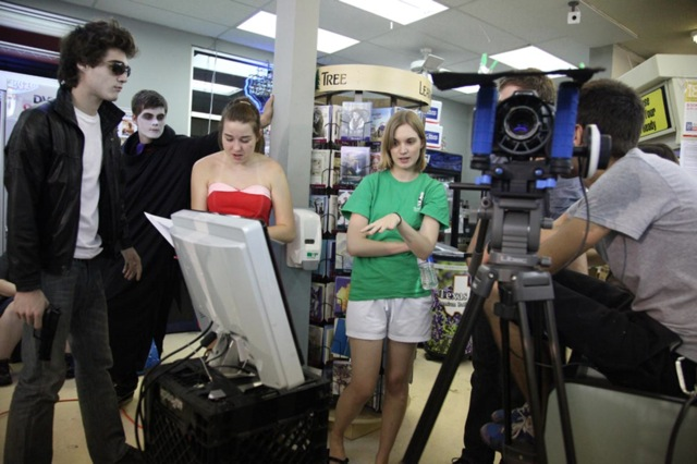 Emily Hagins (center) directs the cast and crew of her third feature, My Sucky Teen Romance.