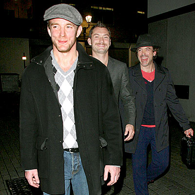 Guy Ritchie, Robert Downey Jr., and Jude Law.