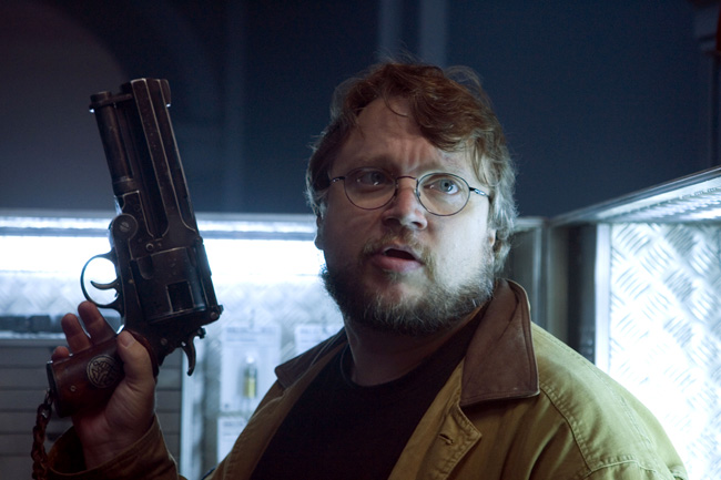 Writer and director Guillermo del Toro holds Hellboy's revolver on the set of Hellboy II: The Golden Army