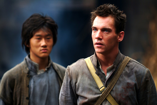 Guang Li (left) as Shi Kai and Jonathan Rhys Meyers (right) as George Hogg in The Children of Huang Shi