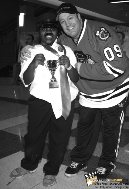 Chicago's 9-year-old Essence Francher is deputized and congratulated by Paul Blart: Mall Cop star Kevin James as the winner of the first-ever Deputy Mall Cop Tryouts for the Chicago Blackhawks children's charity on Jan. 13, 2009 at Chicago's United Center