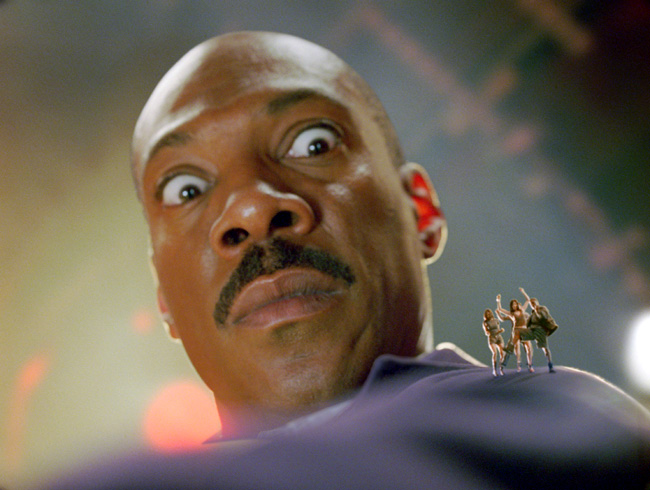 Dave (Eddie Murphy) is shocked by some unexpected micro-boogying happening atop his shoulder in Meet Dave