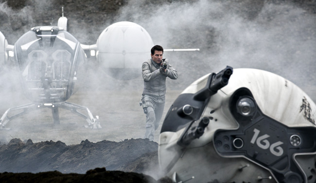 Tom Cruise cautiously approaches a drone in Oblivion