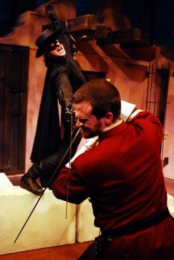 Zorro (James Elly, top) teaches Captain Ramon (Robert Kauzlaric) a bloody lesson in Lifeline Theatre's adaptation of The Mark of Zorro