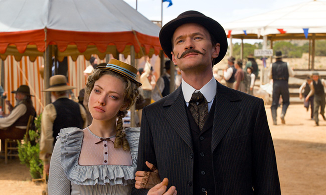 Amanda Seyfried as Louise and Neil Patrick Harris as Foy in A Million Ways to Die in the West