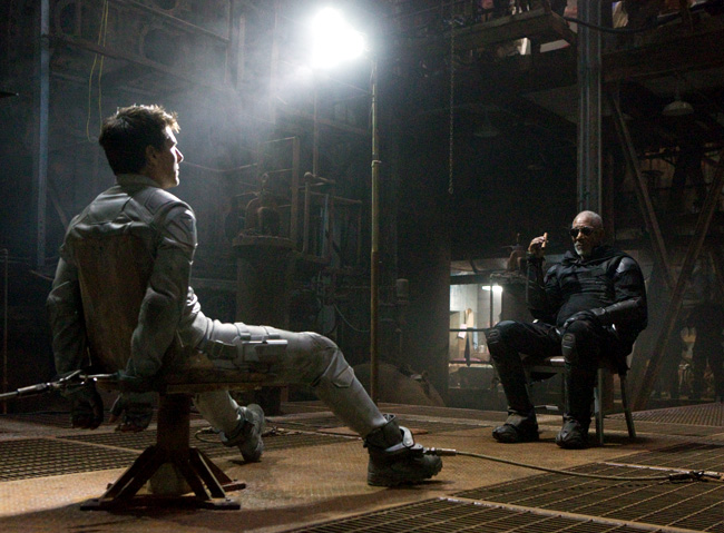 Tom Cruise is grilled by Morgan Freeman in Oblivion