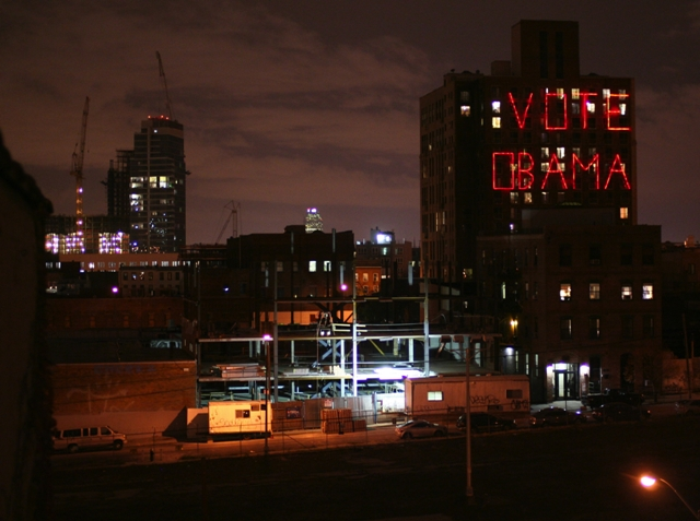 A neon sign proclaiming Obama support glows over Brooklyn in a scene from Jeff Deutchman's 11/4/08.