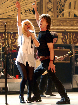 Christina Aguilera (left) and Mick Jagger performing on stage at the Beacon Theater during The Rolling Stones concert film Shine a Light