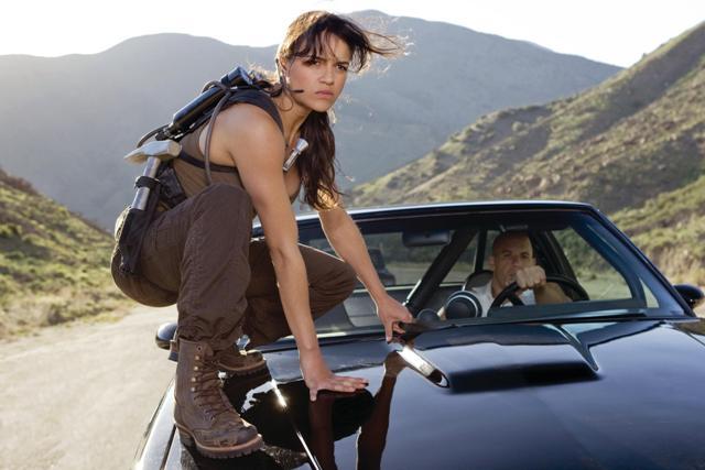 Daredevil Letty (Michelle Rodriguez) and fugitive ex-con Dom Toretto (Vin Diesel) prepare for the fuel heist.