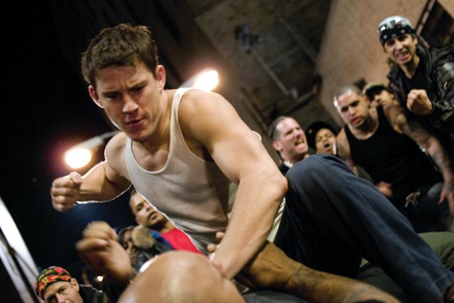 Star brawler Shawn MacArthur (Channing Tatum) faces off with an opponent in the action film Fighting.