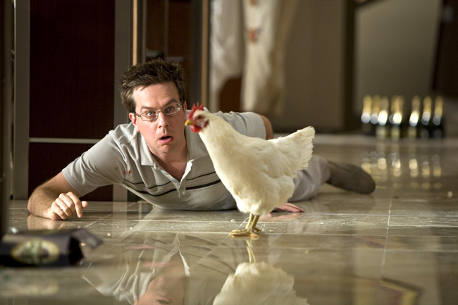 Stu (Ed Helms) wakes up with a hangover and finds a chicken in his hotel room in The Hangover