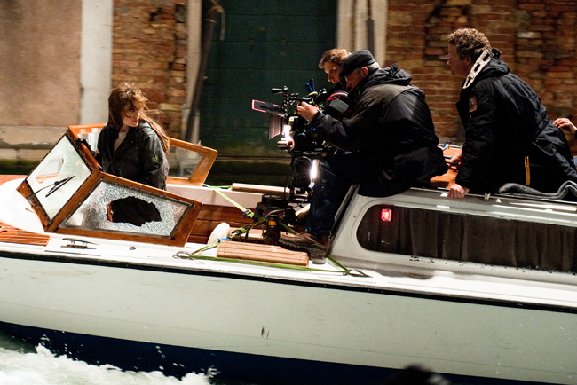 Angelina Jolie with crew and director Florian Henckel von Donnersmarck (right) on the set of The Tourist in Venice, Italy