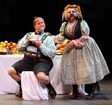 In Willy Wonka in Chicago, the children's journey is strewn with temptations. Augustus Gloop's (George Andrew Wolff) gluttony – encouraged by his mother Mrs. Gloop (Paula Scrofano) – proves to be his downfall